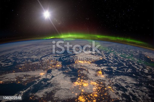 istock Ireland, United Kingdom and Scandinavia on a moonlit night under an amazing aurora. 1060522548