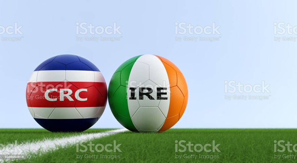 Ireland vs. Costa Rica Soccer Match - Soccer balls in Ireland and Costa Rica national colors on a soccer field. Copy space on the right side - 3D Rendering stock photo