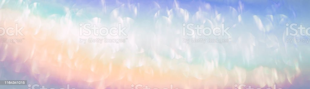 Iridescent holographic rainbow banner. Colorful lens flare bokeh...