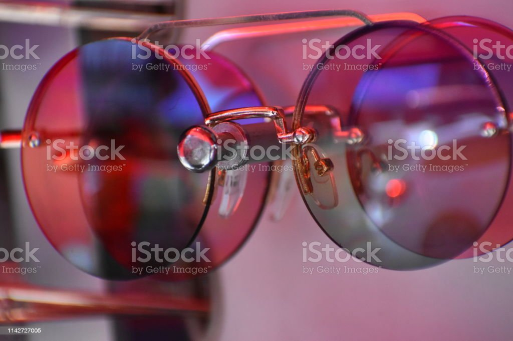 Iridescent sunglasses on a sales rack stock photo
