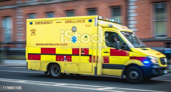 istock Irish ambulance driving fast on the streets of Dublin, Ireland 1179641105