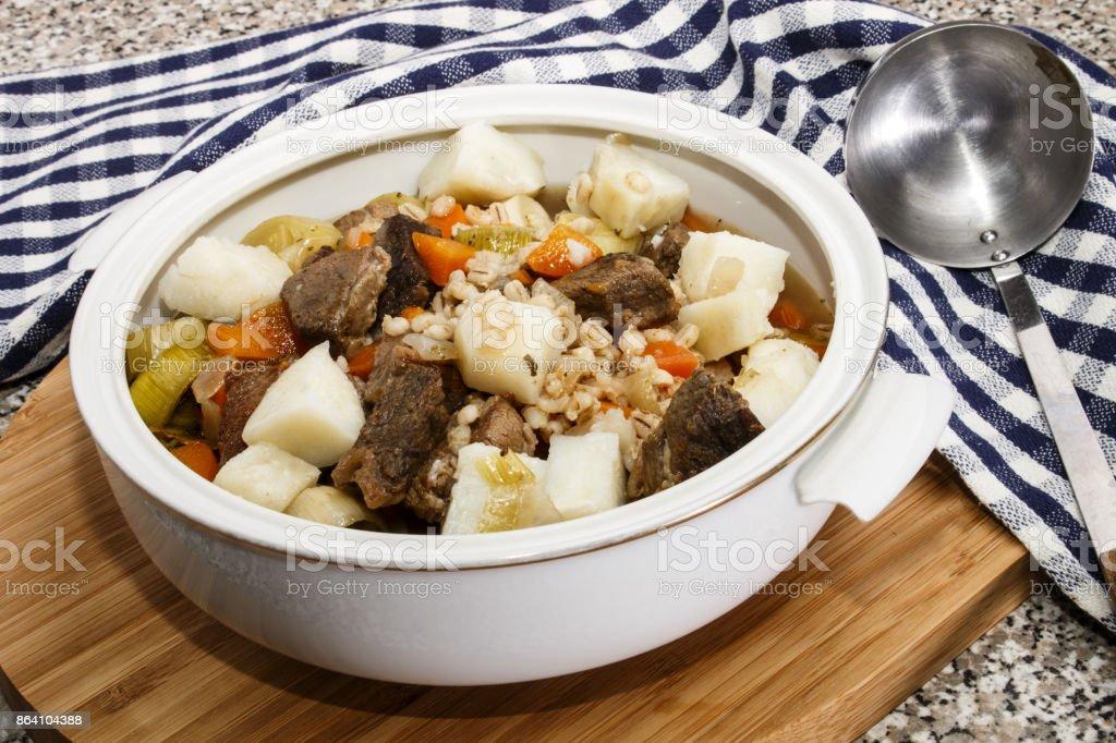 irish beef and barley stew in a terrine royalty-free stock photo