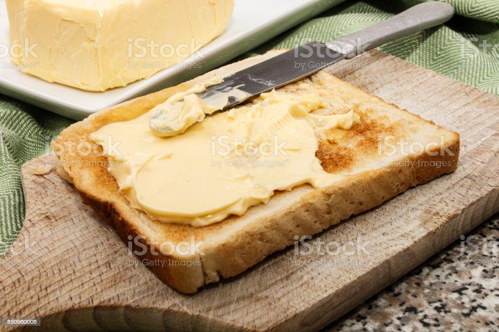 irish butter on warm toast bread stock photo
