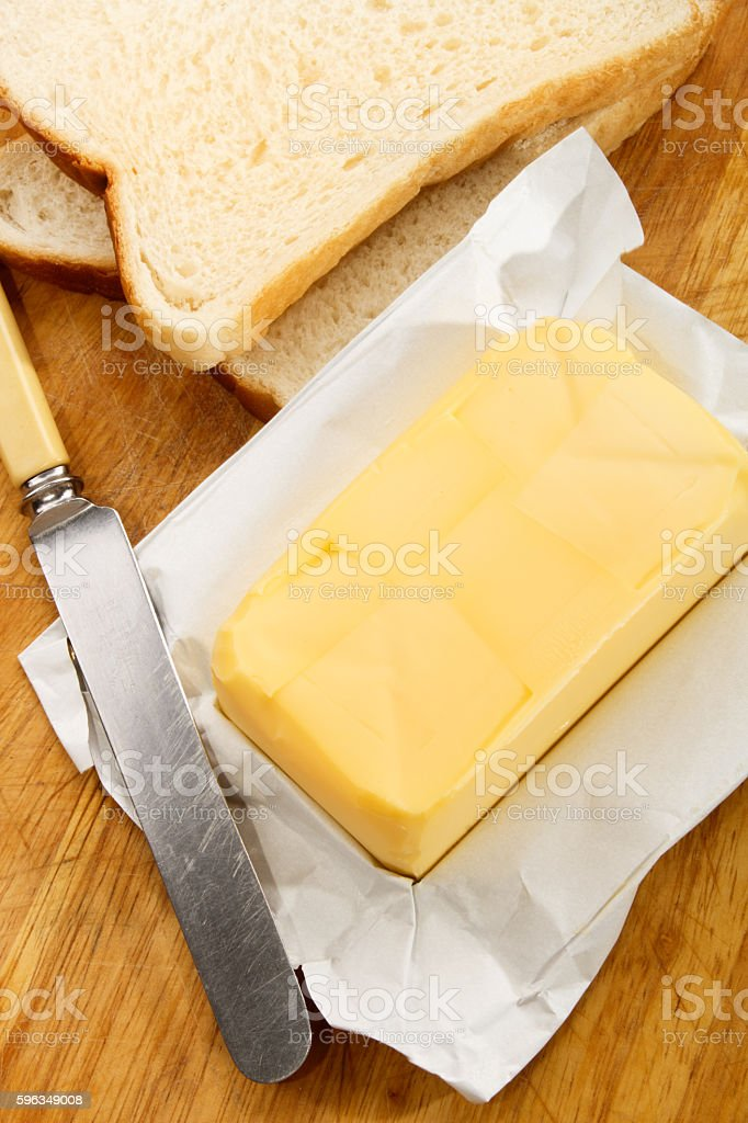 irish butter with fresh sliced bread on a wooden board royalty-free stock photo