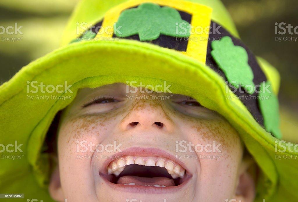 Irish Child St. Patrick's Day Smiling Leprechaun Clover Hat Boy stock photo