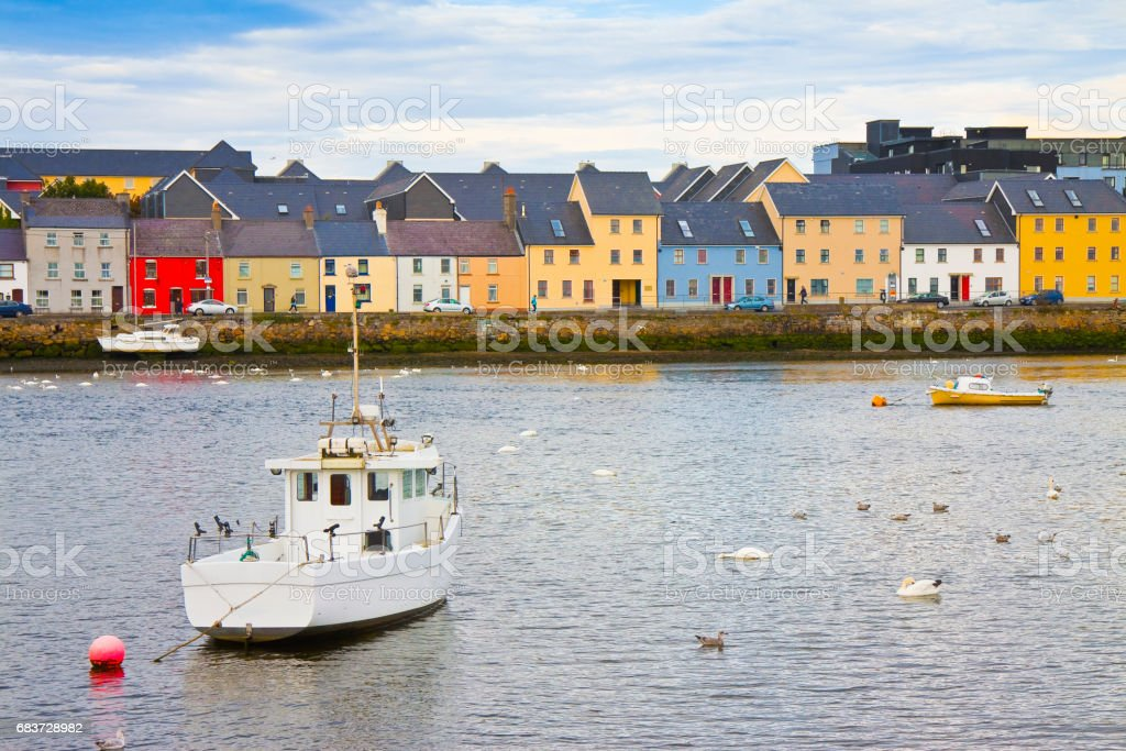 Irish coastal landscape with the typical colored fishermen's houses with sloping roofs (Galway - Ireland) stock photo