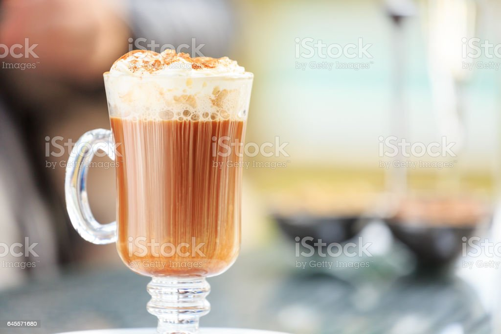 Irish coffee in an outdoor bar. Concept of St Patrick holiday. Holiday background stock photo