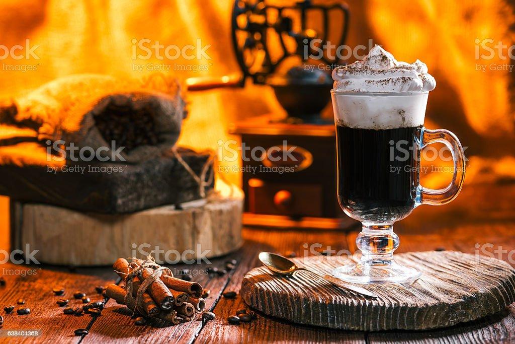 Irish coffee over fireplace light stock photo