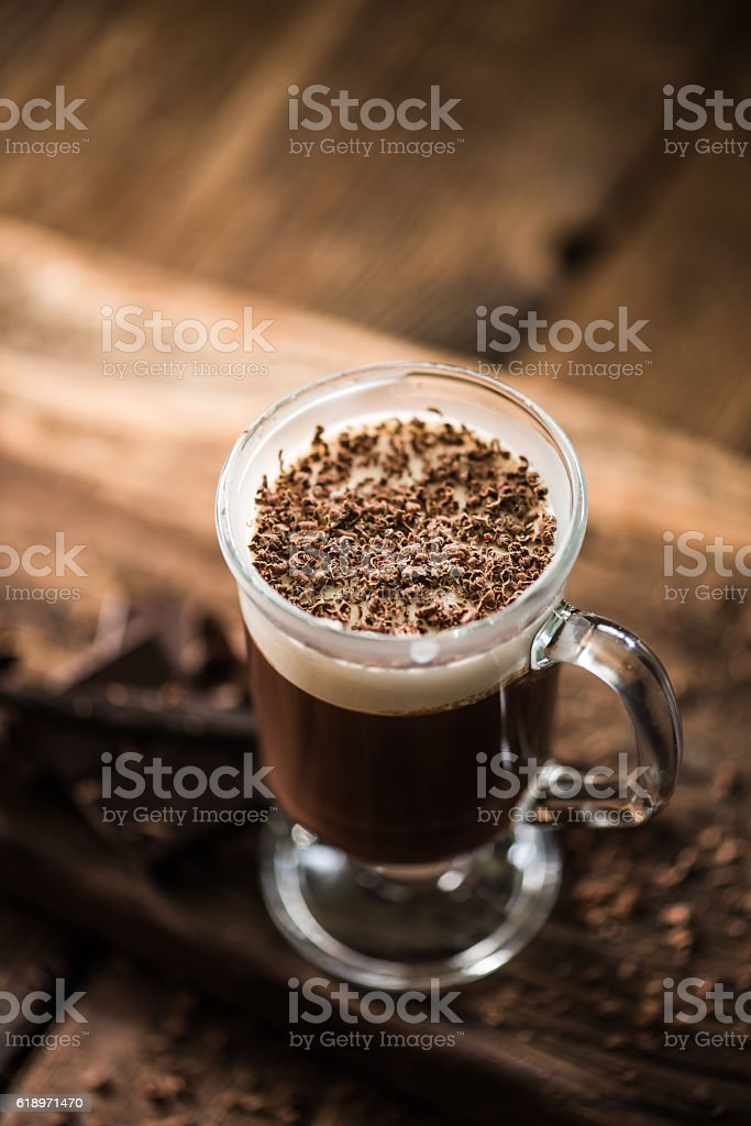 Irish coffee with grated dark chocolate stock photo