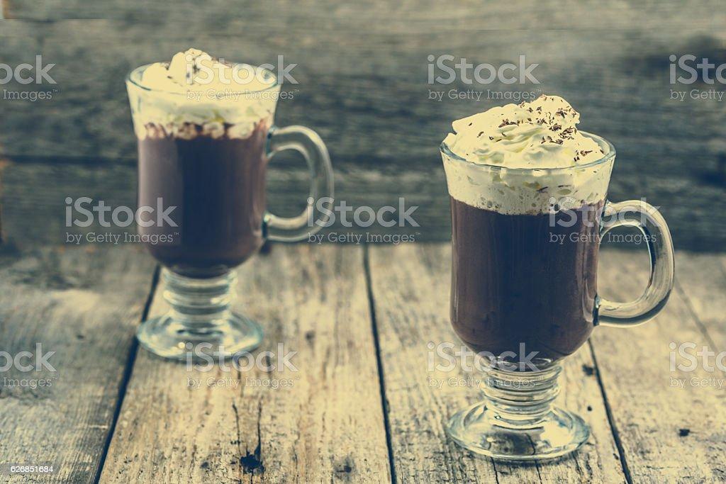 Irish coffee with whipped cream or hot chocolate drink stock photo