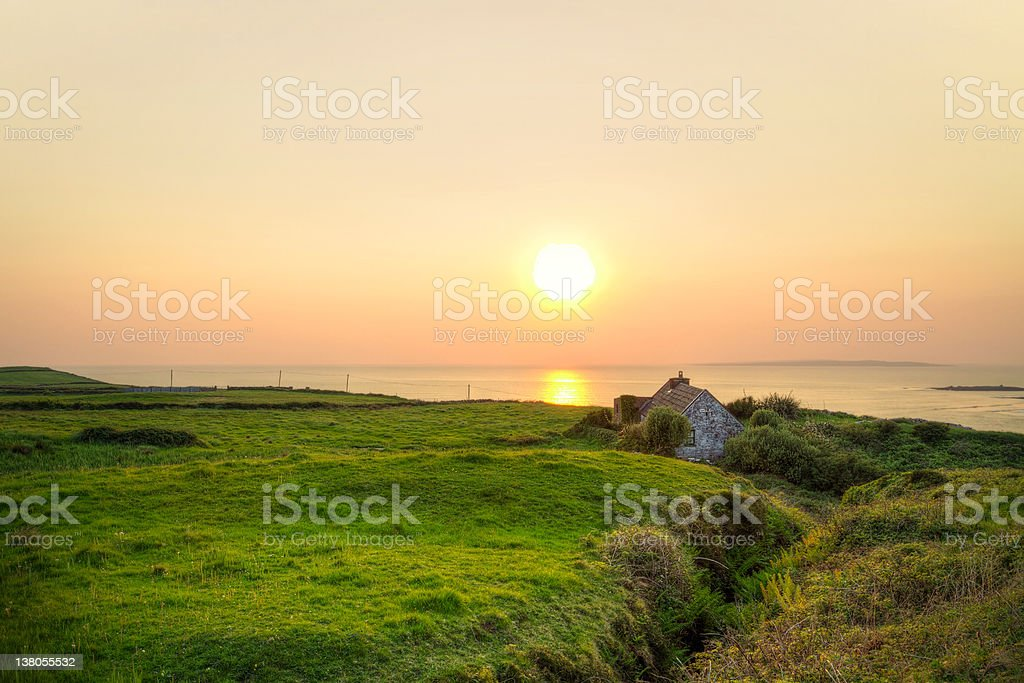 Irish cottage house at the ocean royalty-free stock photo