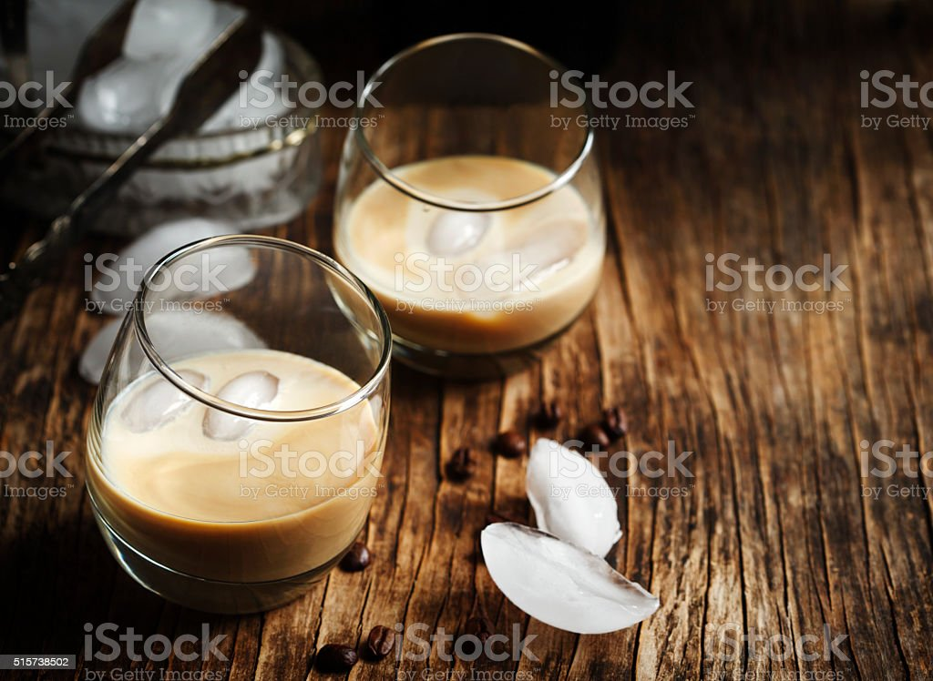 Irish creme liqueur in glass with ice. stock photo