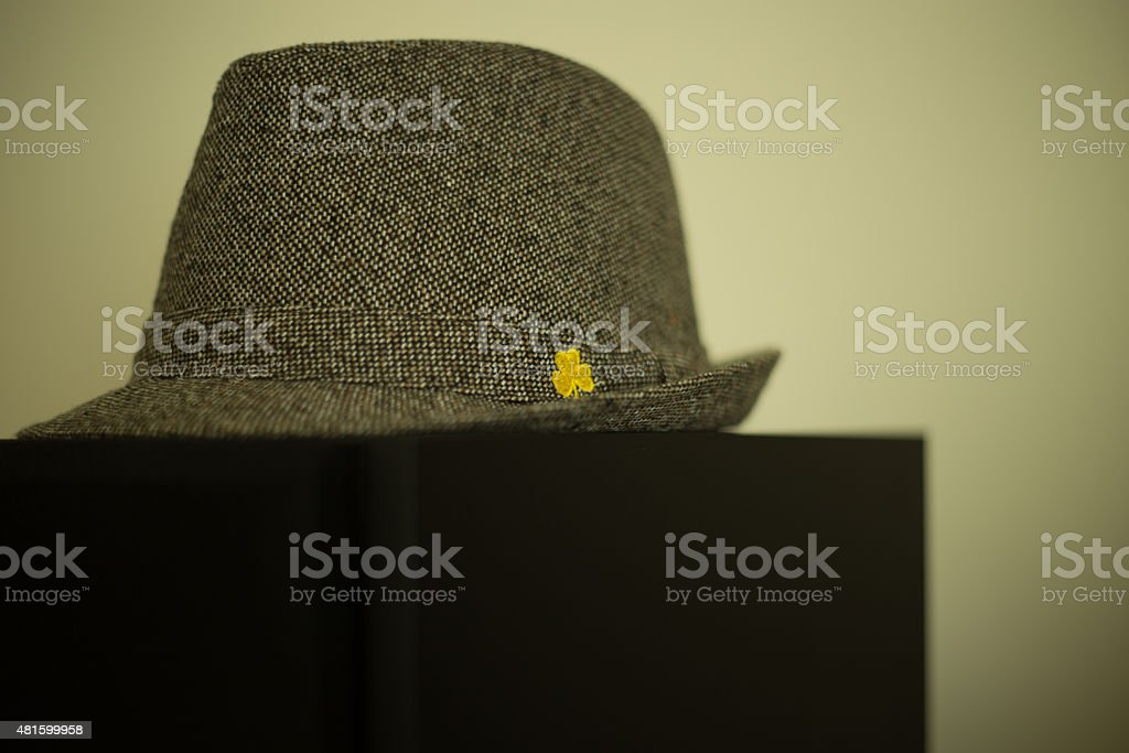 Irish Fedora on a black table stock photo