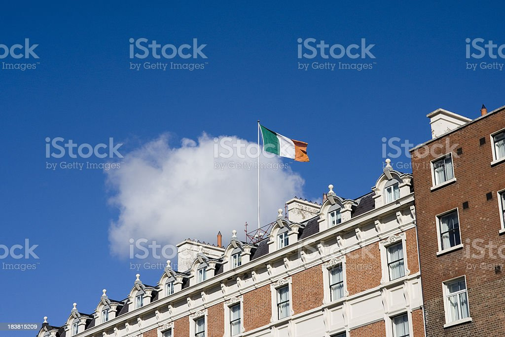 Irish flag and building exteriors in Dublin stock photo