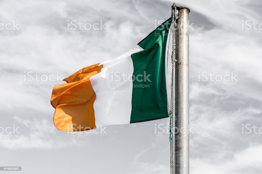 Irish flag fluttering in the wind stock photo