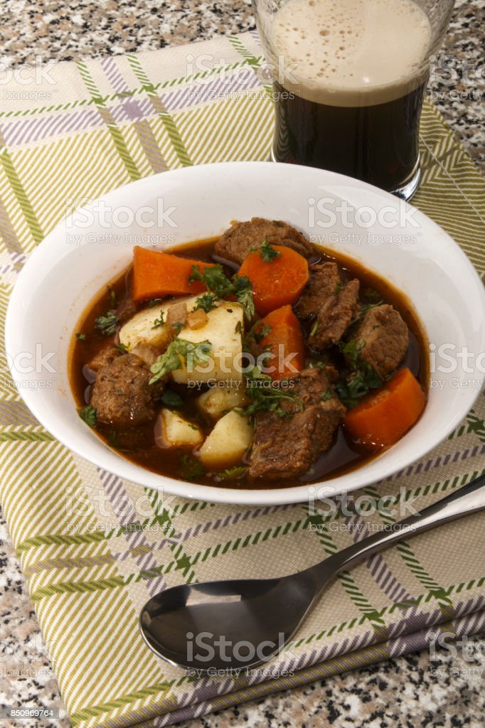 irish guinness beef stew in a bowl stock photo