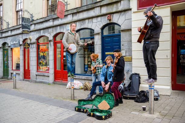 Irish musicians playing at galway street stock photo