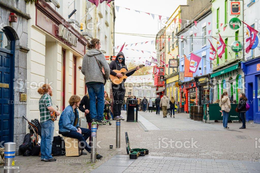 Irish musicians playing at galway street stock photo