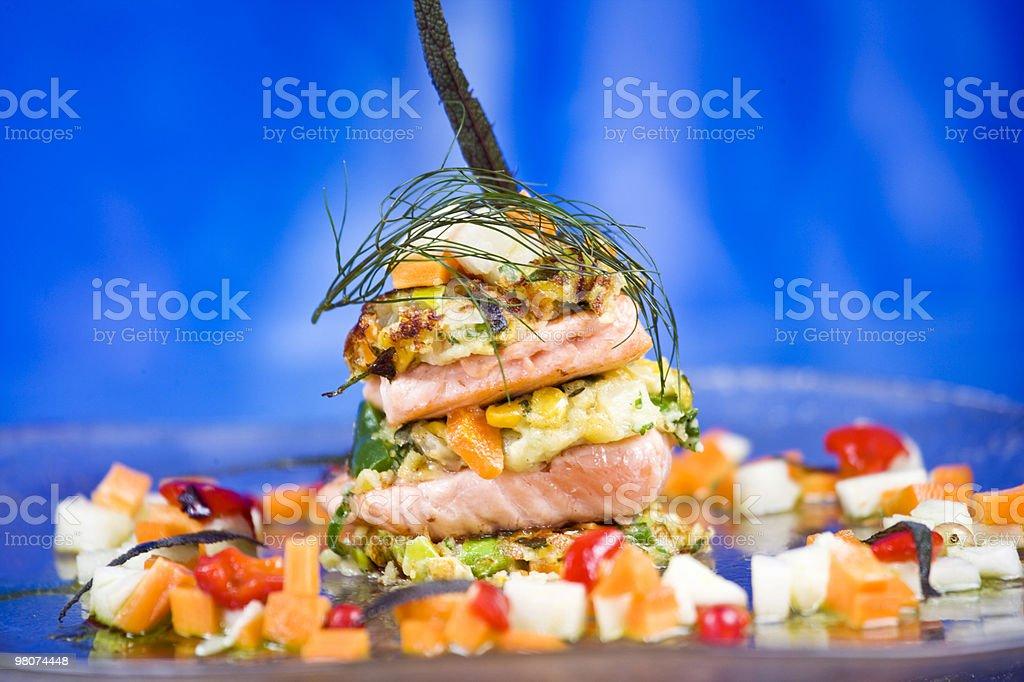 Irish organic salmon with vegetable fritters royalty-free stock photo