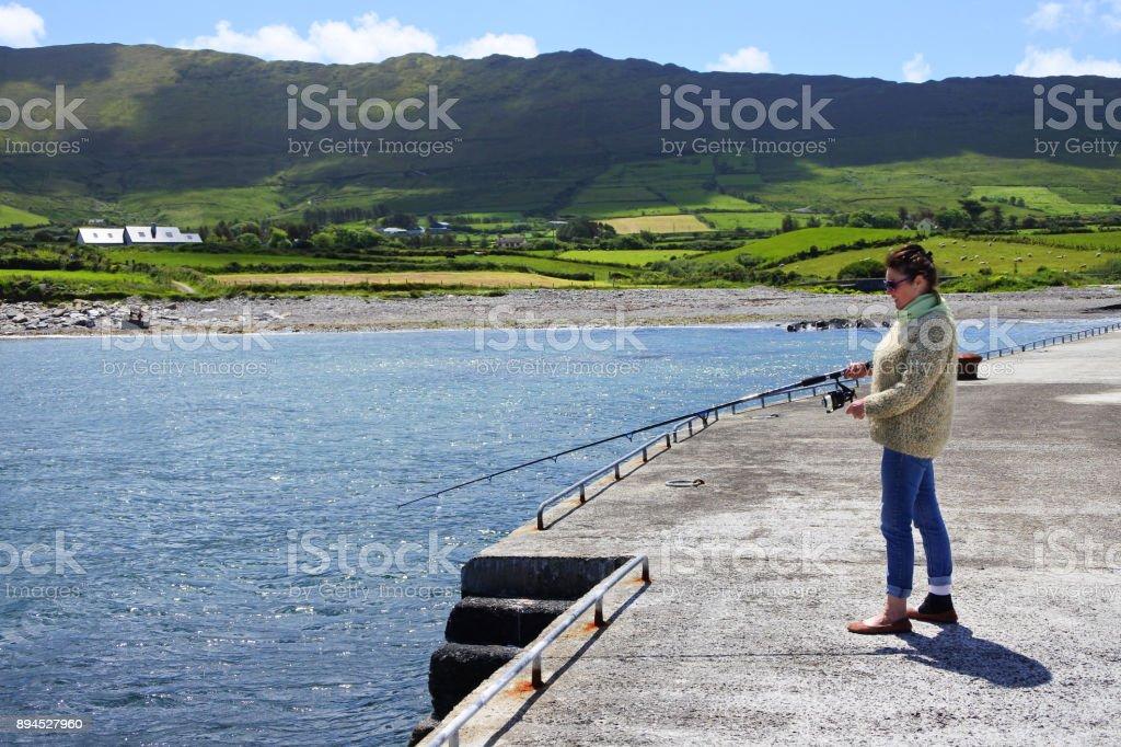 Irish Pier Fishing stock photo