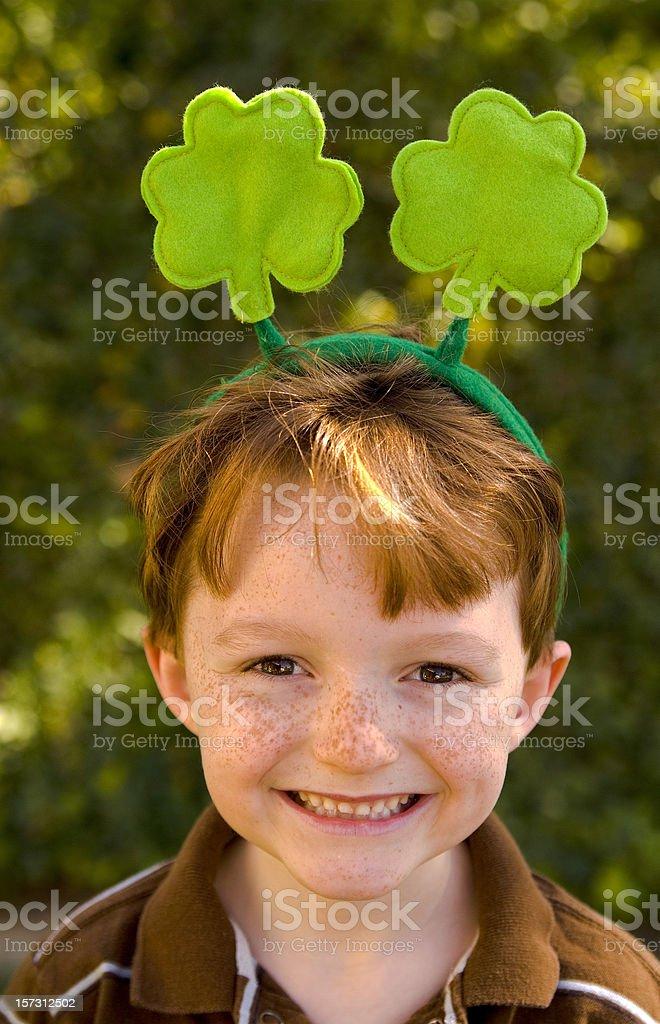 Irish Redhead & Freckles Child Wearing  St. Patrick's Day Clover Headband royalty-free stock photo