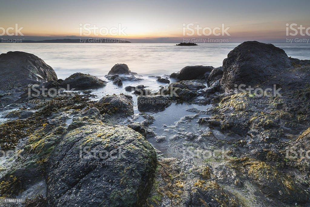 Irish rocky shore at sunrise with colorful sky royalty-free stock photo