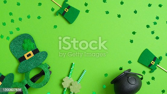 Irish Saint Patrick's day concept. Patricks day frame of leprechaun hats, drinking straws with shamrock, pot of gold, Patricks day glasses. St Patrick's day party invitation template, banner mockup