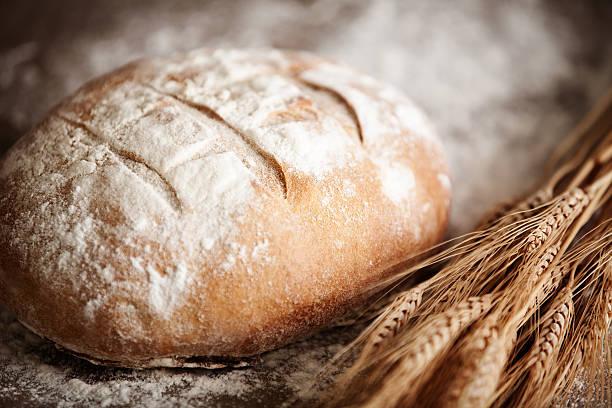 Irish Soda Bread Irish soda bread & dry wheat stalks. round loaf stock pictures, royalty-free photos & images