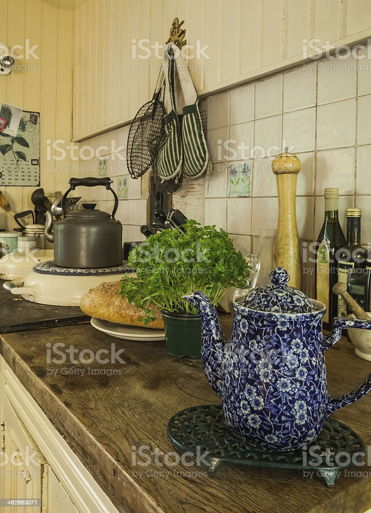 Irish soda bread potted herb and teapot on  kitchen counter royalty-free stock photo