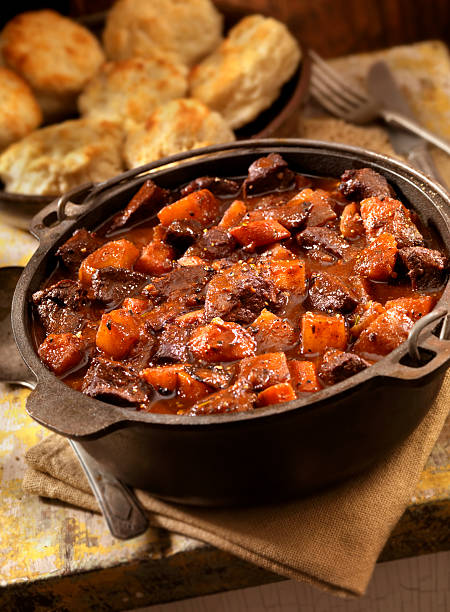 irish stew with biscuits - braised stock pictures, royalty-free photos & images