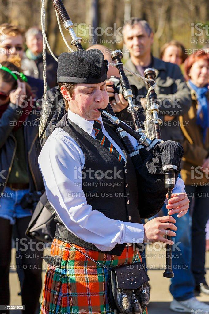 Irish woman playing traditional bagpipe stock photo
