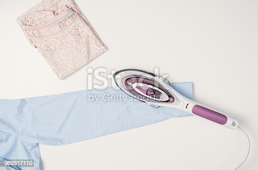 645276668 istock photo Iron and clothes. Ironing clothes concept, top view 963917110