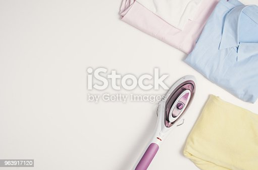 645276668 istock photo Iron and clothes. Ironing clothes concept, top view 963917120