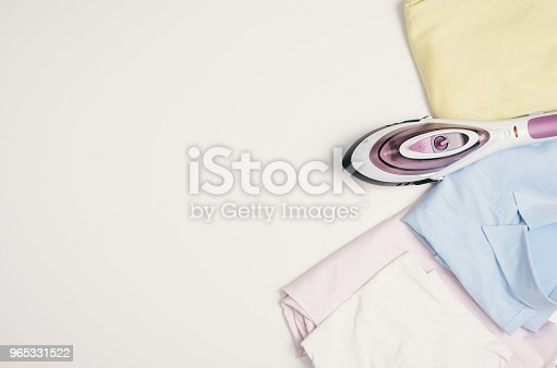 645276668 istock photo Iron and clothes. Ironing clothes concept, top view 965331522