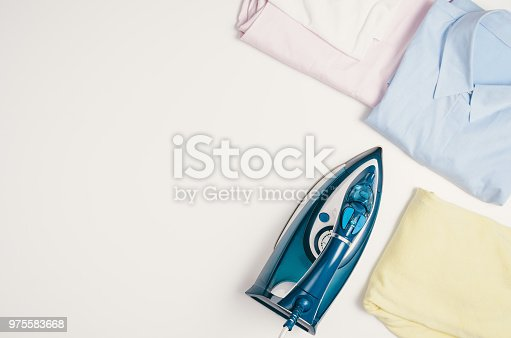 645276668 istock photo Iron and clothes. Ironing clothes concept, top view 975583668