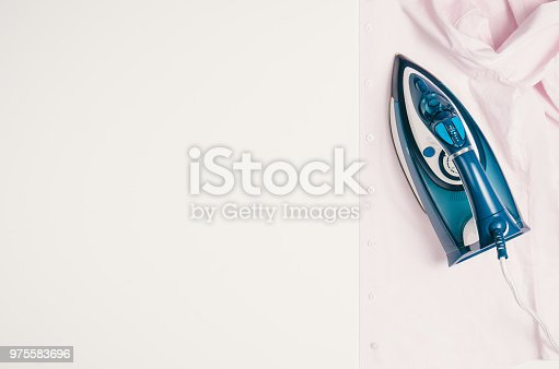 645276668 istock photo Iron and clothes. Ironing clothes concept, top view 975583696