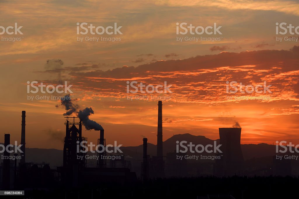 Iron and steel industry under the setting sun foto royalty-free