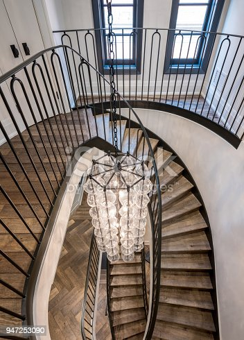 Extreme angle view of Interior of modern luxury home residence in downtown Toronto. Stylish and renovated, View of Iron and wood staircase.