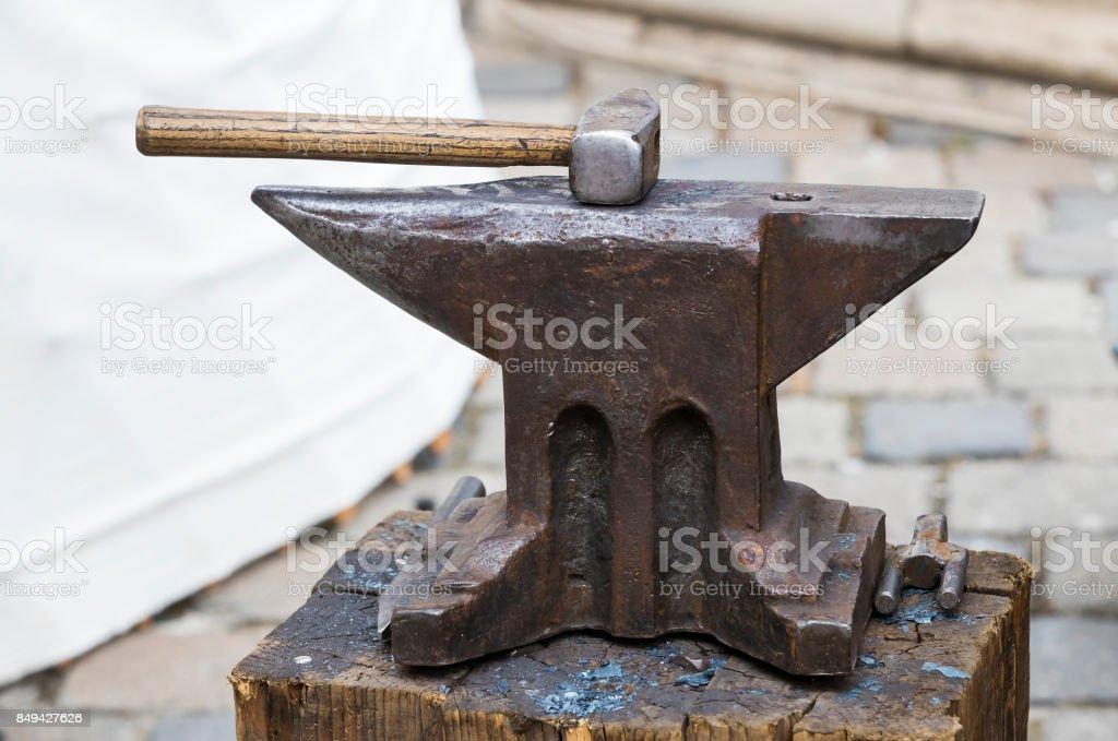 Iron anvil with a blacksmith's forge stock photo