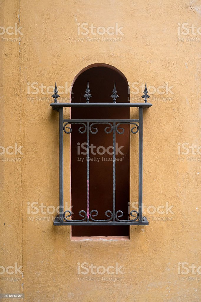 Iron bars over long curved window stock photo