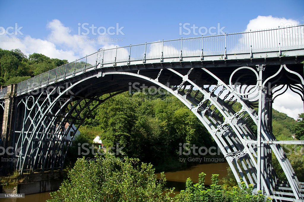Iron bridge over a lake in the middle of the forest stock photo