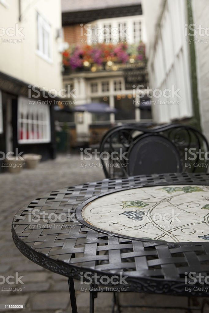 iron cafe table in an alley Windsor, UK stock photo
