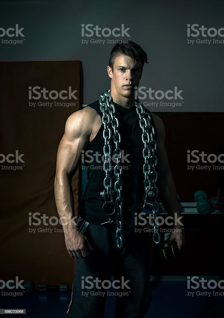 Iron chain on fit man foto royalty-free
