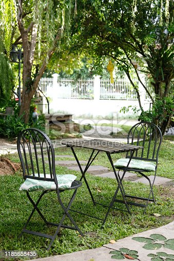 647209792 istock photo iron chair and table in the cafe garden 1185658435
