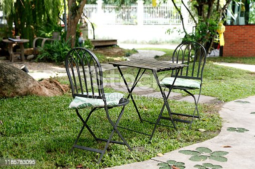 647209792 istock photo iron chair and table in the cafe garden 1185783095