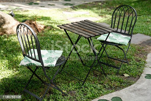 647209792 istock photo iron chair and table in the cafe garden 1185783106