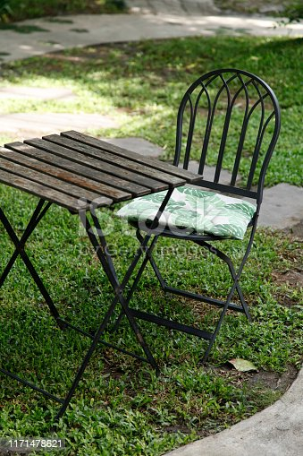 647209792 istock photo iron chair and table in the cafe 1171478621