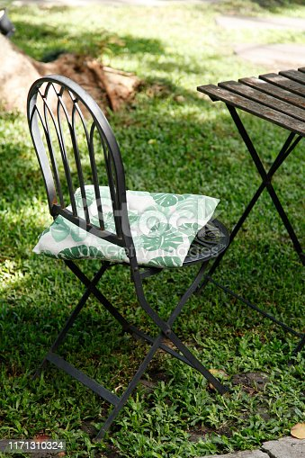 647209792 istock photo iron chair in the cafe garden 1171310324