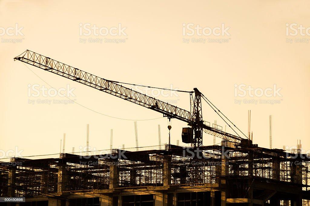 Iron crane in construction Site silhouettes stock photo
