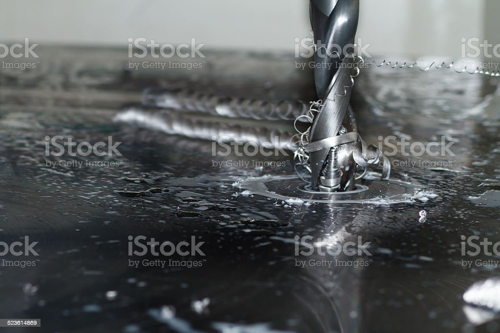 Iron drill in action stock photo